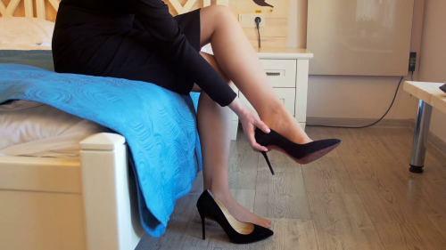 videoblocks-4k-footage-of-young-businesswoman-sitting-on-bed-and-taking-off-high-heels-shoes-after-hard-working-day_b-_obrl-b_thumbnail-full05